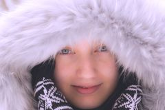 Portrait of a beautiful girl with blue eyes in the winter Royalty Free Stock Image