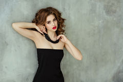 Portrait of a beautiful glamorous brunette with curly hair and b royalty free stock images