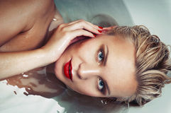 Portrait of a beautiful glamourous blonde in water, spa concept. Close up portrait Royalty Free Stock Images