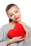 Portrait of Beautiful gorgeous smiling woman with glamour bright makeup and red heart in hand Royalty Free Stock Photography