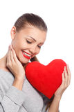 Portrait of Beautiful gorgeous smiling woman with glamour bright makeup and red heart in hand Royalty Free Stock Photos