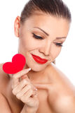 Portrait of Beautiful gorgeous smiling woman with glamour bright makeup and red heart in hand Stock Image