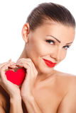 Portrait of Beautiful gorgeous smiling woman with glamour bright makeup and red heart in hand Royalty Free Stock Image