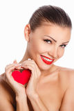 Portrait of Beautiful gorgeous smiling woman with glamour bright makeup and red heart in hand Royalty Free Stock Images