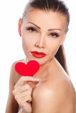 Portrait of Beautiful gorgeous smiling woman with glamour bright makeup and red heart in hand Stock Photo