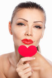 Portrait of Beautiful gorgeous woman with glamour bright makeup and red heart in hand Stock Photos