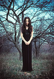 Portrait of beautiful goth girl amongst the faded trees Royalty Free Stock Images