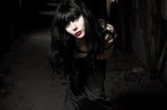 Portrait of beautiful goth girl in dark tunnel Stock Photos