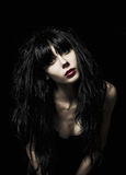 Portrait of beautiful goth girl among the darkness Stock Image