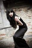 Portrait of beautiful goth woman among the ruins stock photo