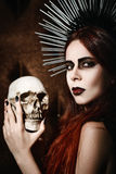 Portrait of beautiful gothic girl holding the skull. Portrait of a beautiful gothic girl holding the skull stock images
