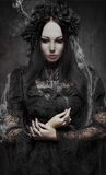 Portrait of beautiful Gothic woman in dark dress. In studio Royalty Free Stock Image