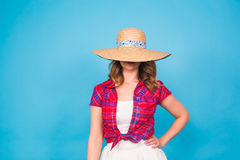 Beautiful graceful woman in elegant hat with a wide brim. Beauty, fashion concept. Portrait of a beautiful graceful woman in elegant hat with a wide brim stock photography