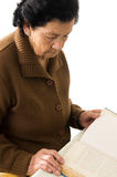 Portrait of beautiful grandmother reading a book Royalty Free Stock Images