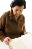 Portrait of beautiful grandmother reading a book Stock Photography