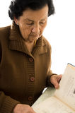 Portrait of beautiful grandmother reading a book Royalty Free Stock Photography
