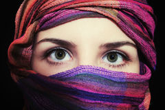 Portrait of beautiful green-eyed woman in hijab. On black background Royalty Free Stock Photography