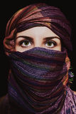Portrait of beautiful green-eyed woman in hijab. On black background Royalty Free Stock Photo