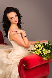 Portrait of a beautiful happy bride on red sofa Stock Photo