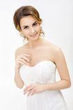 Portrait of beautiful happy bride in wedding dress on white background Royalty Free Stock Photography