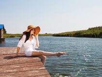 Portrait of the brunette woman on a pier Royalty Free Stock Images