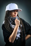 Portrait of beautiful happy girl with dreadlocks. In cap. Music concept Royalty Free Stock Photo