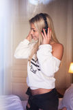 Portrait of beautiful happy girl with headphones listening to rock music. royalty free stock images