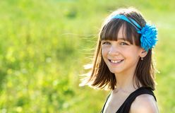 Portrait of a beautiful and happy girl outdoors in summer, stock photos