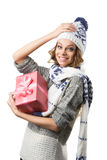 Portrait of beautiful happy girl in sweater hat and mittens with box of Christmas gift Royalty Free Stock Image