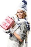 Portrait of beautiful happy girl in sweater hat and mittens with boxes of Christmas gifts Stock Photography
