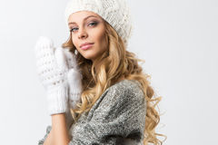 Portrait of beautiful happy girl in sweater hat and mittens Royalty Free Stock Images