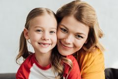 portrait of beautiful happy mother and daughter smiling stock photo