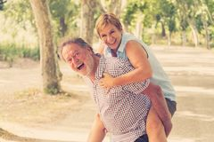 Portrait of a beautiful happy senior couple in love dancing in the park. Happy smiling senior couple in love, dancing and having fun in the park. Being together Royalty Free Stock Images