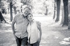 Portrait of a beautiful happy senior couple in love relaxing in the park stock photography