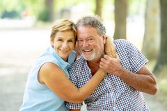 Portrait of a beautiful happy senior couple in love relaxing in the park. Happy smiling senior couple in love, relaxing, dancing and having fun in the park Stock Photography