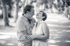 Portrait of a beautiful happy senior couple in love relaxing in the park. Happy smiling senior couple in love, relaxing, dancing and having fun in the park Royalty Free Stock Images