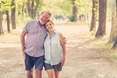 Portrait of a beautiful happy senior couple in love relaxing in the park. Happy smiling senior couple in love, relaxing, dancing and having fun in the park Stock Photos