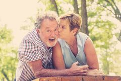 Portrait of a beautiful happy senior couple in love relaxing in the park. Happy smiling senior couple in love, relaxing, dancing and having fun in the park Stock Image