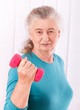 Happy senior woman with dumbbells Royalty Free Stock Image