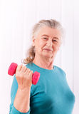 Happy senior woman with dumbbells Royalty Free Stock Photography