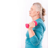 Happy senior woman with dumbbells Stock Image