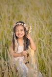 Portrait of beautiful happy smiling girl to meadow in nature on sunny day Royalty Free Stock Photos