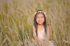 Portrait of beautiful happy smiling girl to meadow in nature on sunny day Stock Image