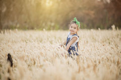 Portrait of beautiful happy smiling girl to meadow in nature on sunny day Royalty Free Stock Images