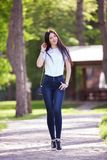 Portrait of beautiful happy stylish woman in blue jeans royalty free stock photos