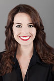 Portrait of a beautiful happy toothy smiling woman. Closeup portrait of a beautiful happy brown haired woman toothy smiling isolated on gray background Royalty Free Stock Image