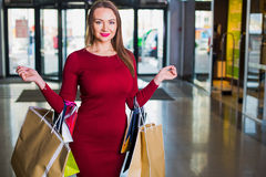 Portrait of beautiful happy  welldressed  woman with shopping bags. Shopping center. Successful Day sales Royalty Free Stock Photography