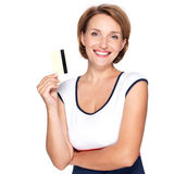 Portrait of a beautiful  happy woman with credit card. Portrait of a beautiful young adult  happy woman with credit card over white background Royalty Free Stock Photography