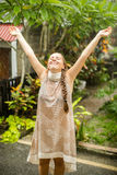 Portrait of a beautiful happy woman enjoying tropical rain falli Stock Images