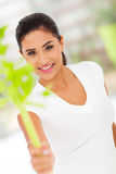 Woman holding celery Royalty Free Stock Image